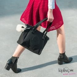 [Kipling] A classy black tote with a dash of fun! Pair the Amiel in Black Padded with a red tulle skirt
